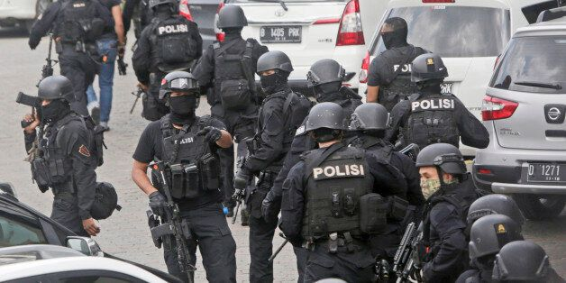 In this Thursday, Jan. 14, 2016, file photo, police officers are deployed near the site of an explosion...