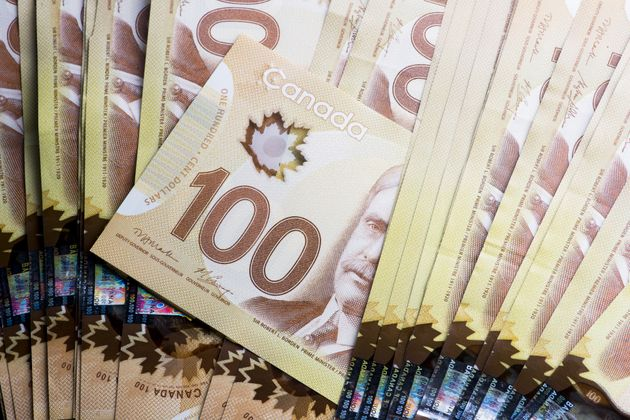 This photo shows $100 Canadian banknotes laid out on a