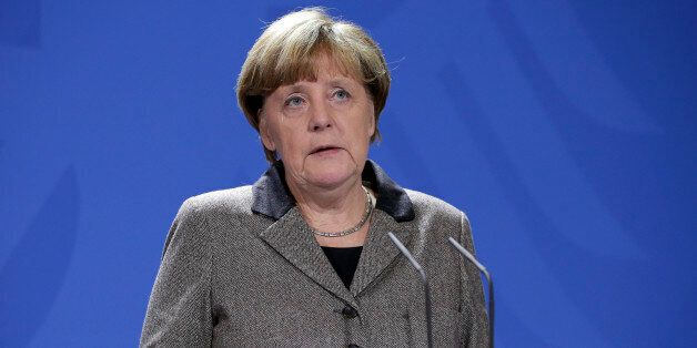 German Chancellor Angela Merkel addresses the media during a statement at the chancellery in Berlin,...