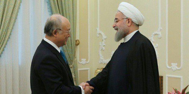Photographie remise par le bureau de la présidence iranienne montrant Yukiya Amano, président de l'Agence...