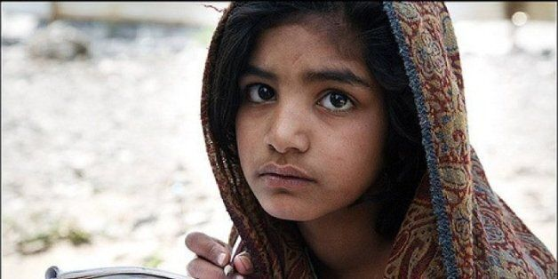 A little girl in Pakistan tries to study in an open field, her poor family lost everything in the recent...
