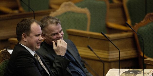 Martin Henriksen, left, and Christian Langballe from The Danish People's Party, sit in Parliament, in...