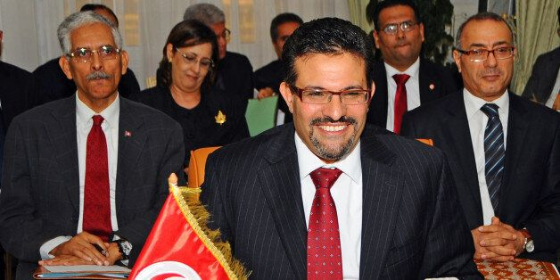 Tunisian Foreign Minister Rafik Abdessalem attends a meeting with his Egyptian and Libyan counterparts,...