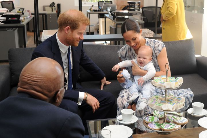 Meghan holds their baby son Archie as they meet with Archbishop Desmond Tutu at the Tutu Legacy Foundation in Cape Town on Se