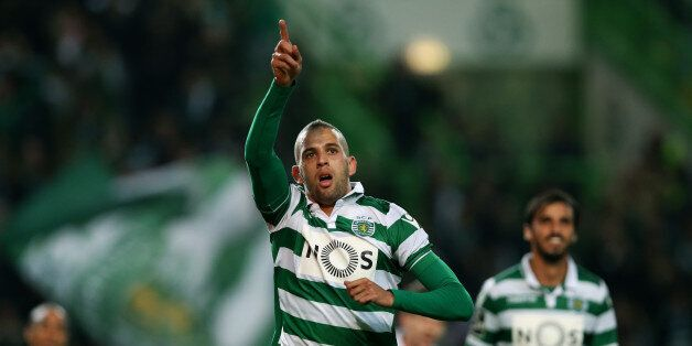 Sporting's Islam Slimani, celebrates after scoring the opening goal during a Portuguese league soccer...