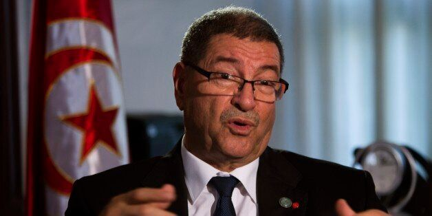 Tunisian Prime Minister Habib Essid speaks with The Associated Press during an interview ahead of a two-day...