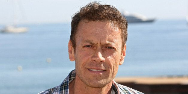 Italian actor, producer, director, Rocco Siffredi poses for photographers during the MIPTV (International...