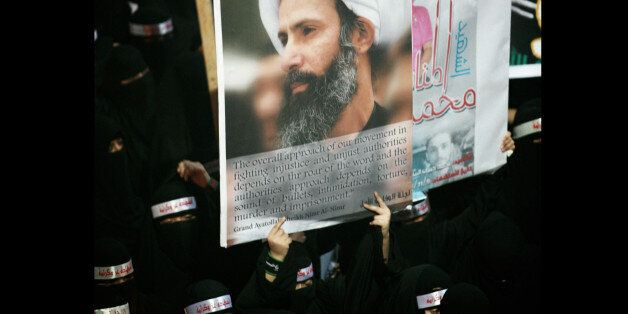 FILE - In this Sunday, Sept. 30, 2012 file photo, a Saudi anti-government protester carries a poster...