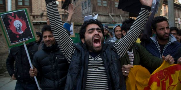A Kashmiri Shiite Muslim man shouts slogans against the execution of Sheikh Nimr al-Nimr, during a protest...