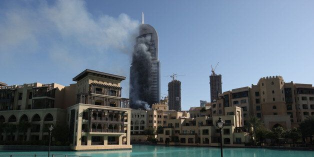 Smoke billows from the Address Downtown skyscraper in Dubai, United Arab Emirates on Friday, Jan. 1,...
