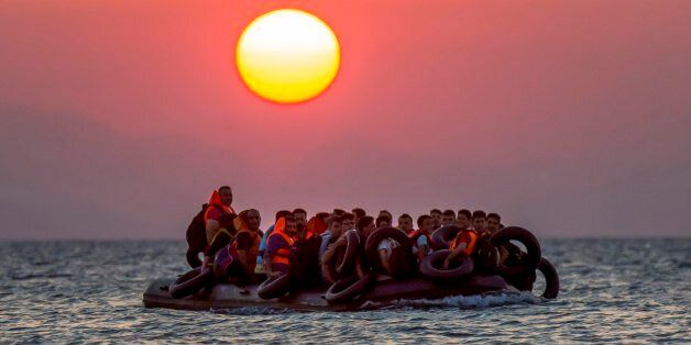 FILE - Migrants on a dinghy arrives at the southeastern island of Kos, Greece, after crossing from Turkey,...