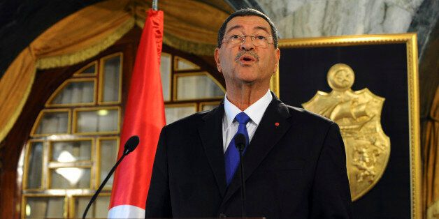 New Tunisian Prime Minister Habib Essid presents his second government to the medias, Monday, Feb.2,...