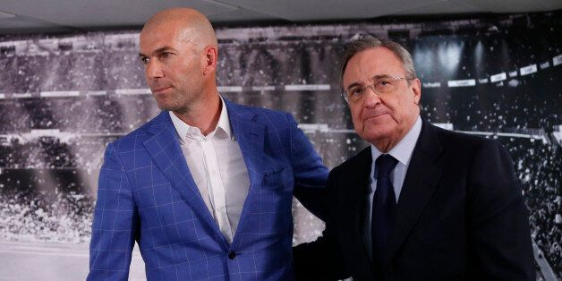 Real Madrid's President Florentino Perez, right, stands with newly appointed coach Zinedine Zidane at...