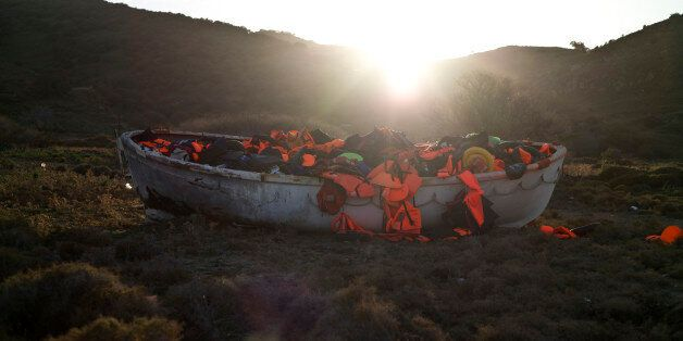 A wooden boat full of life jackets used by refugees and migrants to cross the Aegean sea from the Turkish...