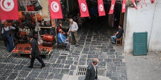 People walk through the Medina market in Tunis, Tunisia, Monday, Oct. 26, 2015. (AP Photo/Mosa'ab