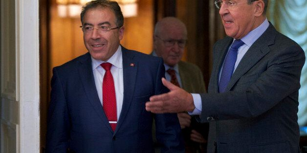 Russian Foreign Minister Sergey Lavrov, right, welcomes his Tunisian counterpart Mongi Hamdi during their...