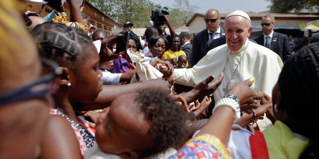 Pope Francis is cheered by locals as he visits a refugee camp, in Bangui, Central African Republic, Sunday,...