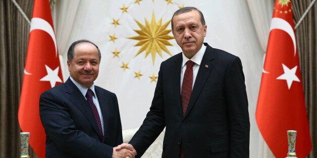 Turkish President Recep Tayyip Erdogan, right, and President of Iraq'a northern Kurdish region, Massoud...
