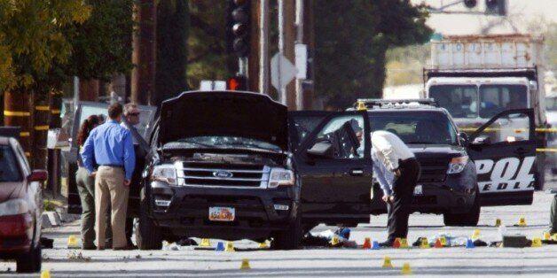 Des enquêteurs recherchent des indices sur la véhicule utilisé par le couple d'origine pakistanaise auteur...