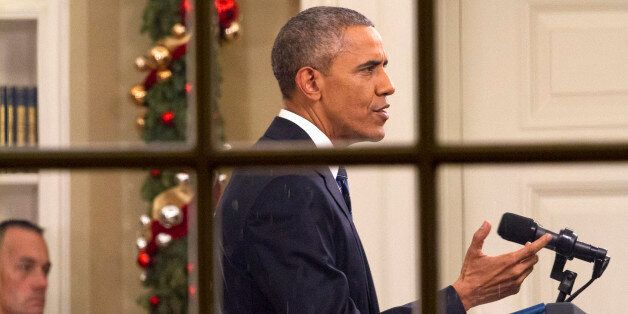 President Barack Obama addresses the nation from the Oval Office at the White House in Washington, Sunday...