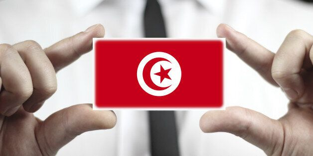 Businessman holding a business card with Tunisia