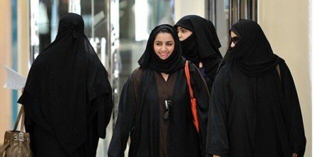 Saudi women walk inside the Faysalia shopping centre in