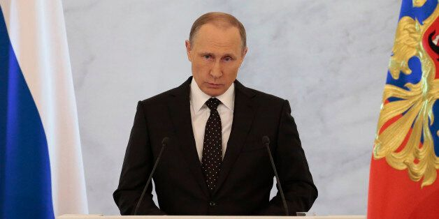 Russian President Vladimir Putin gives his annual state of the nation address in the Kremlin in Moscow,...
