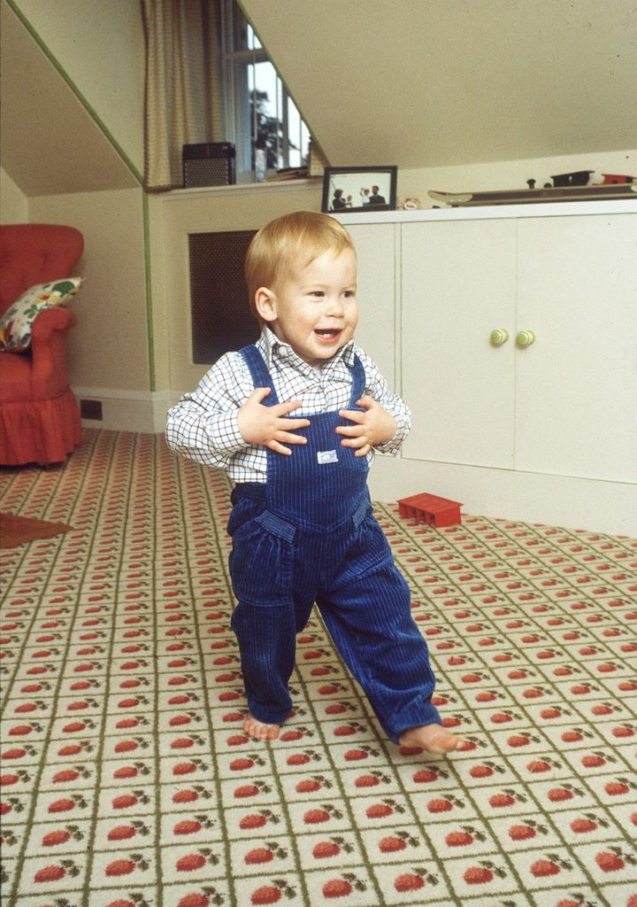Barefoot Prince Harry takes his first steps at home in the playroom in Kensington Palace on Oct. 22, 1985.