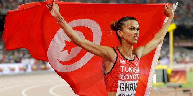 Tunisia's Habiba Ghribi celebrates after winning a silver medal in the women's 3000m steeplechase final...