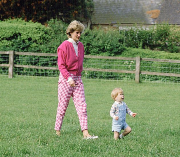 Prince Harry and Princess Diana walking in the grounds at