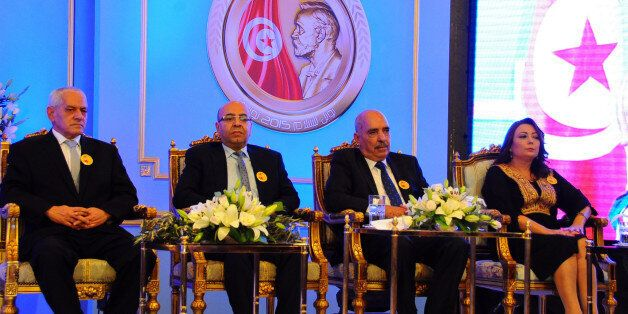 Wided Bouchamaoui president of the Tunisian employers, right, Abdessattar Ben Moussa, president of the...