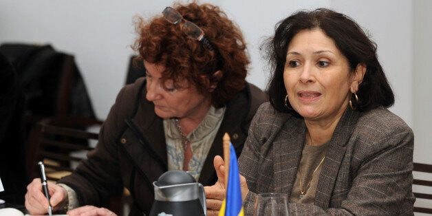 Tunisian journalist and Human Rights activist Sihem Ben Sedrine (R) talks next to French outgoing eurodeputy...