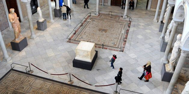 Tunisians stroll in Tunisia's National Bardo Museum Monday, March 30, 2015. The Bardo Museum is open...