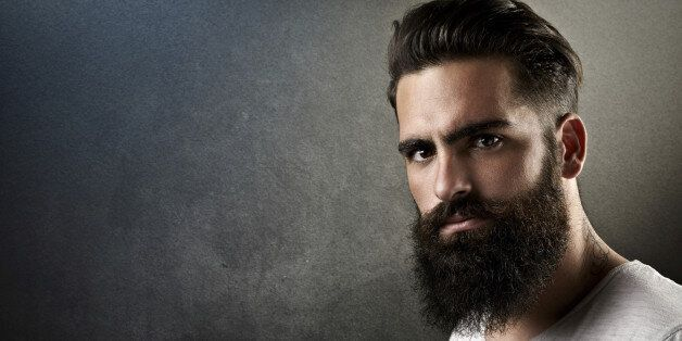Portrait of a brutal bearded man with