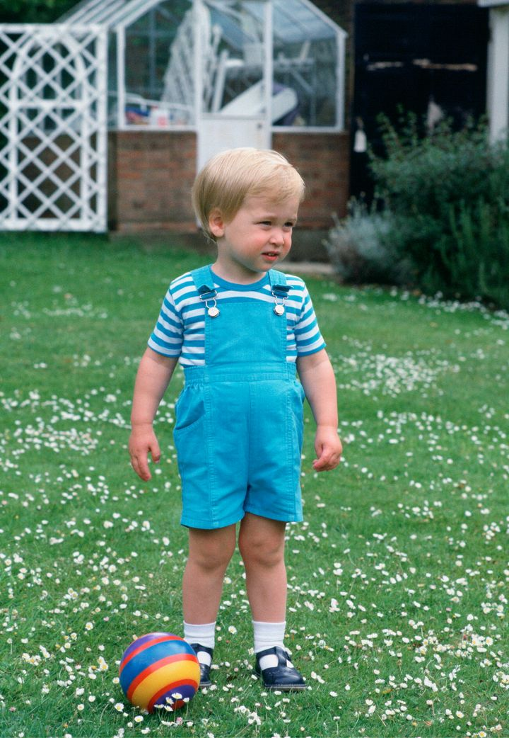 Prince William is a sweetheart in overalls just before his second birthday.