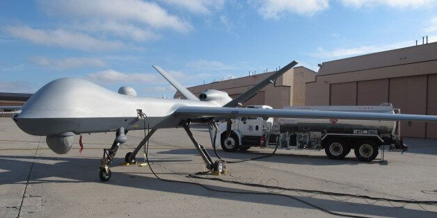 In this Nov. 3, 2015, photo, a Predator drone owned by the U.S. Customs and Border Protection sits on...