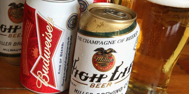 CHICAGO, IL - SEPTEMBER 15: In this photo illustration, cans of Miller High Life and Budweiser beer that...