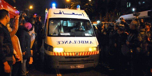An ambulance rushes to the scene of a bus explosion in the center of the capital, Tunis, Tunisia, Tuesday,...