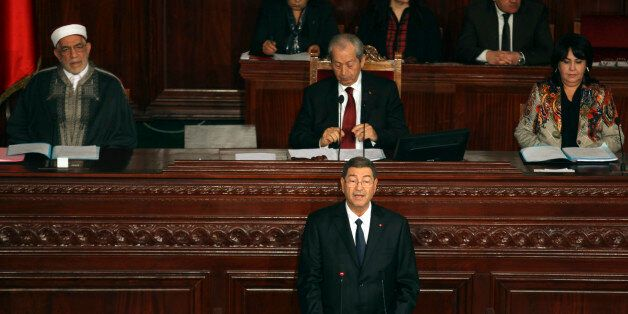 Tunisian Prime Minister Habib Essid delivers his speech at the national assembly in Tunis, Wednesday,...