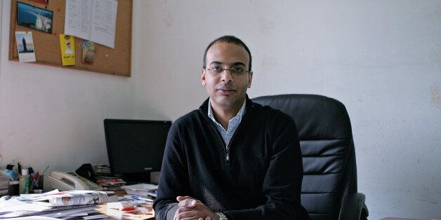 This Dec. 7, 2011 photo, shows Hossam Bahgat in his office at the Egyptian Initiative for Personal Rights...