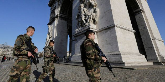 French soldiers patrol at the Arch of Triumph in the Champs Elysees district of Paris, France, Sunday,...