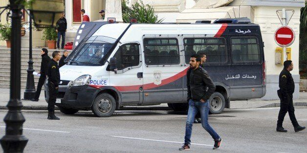 A police van parks in downtown Tunis, Thursday, Nov. 26, 2015. Tunisian authorities have identified a...