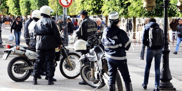 Police officers patrol in the main avenue of Tunis, Thursday, Nov. 26, 2015. Tunisian authorities have...