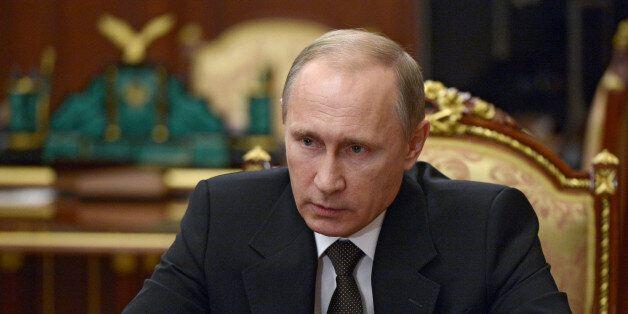 Russian President Vladimir Putin heads a meeting on Russian plane crash in Egypt in Moscow's Kremlin,...