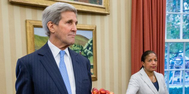 Secretary of State John Kerry and National Security Adviser Susan Rice stand in the Oval Office in Washington,...