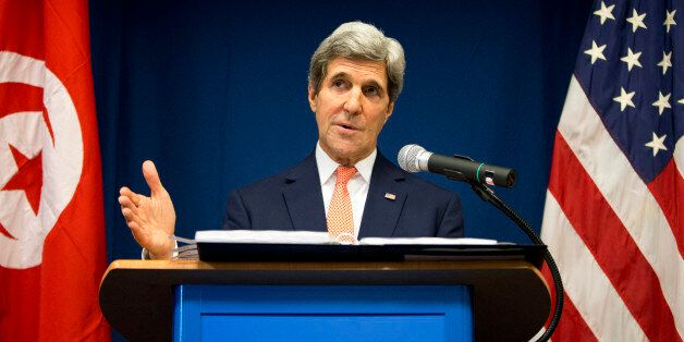 US Secretary of State John Kerry speaks during a news conference at the U.S. Embassy on Tuesday, Feb....