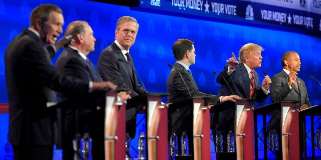 John Kasich, left, and Donald Trump, second from right, argue across fellow candidates during the CNBC...