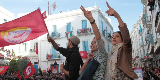 Members of the leftist UGTT union commemorate the 1955 assassination of a historic member before they...