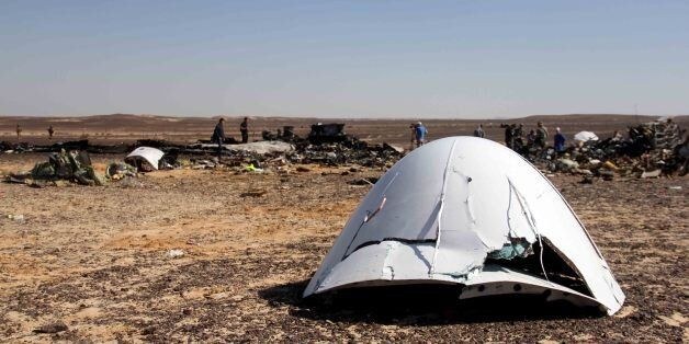 Debris of a Russian airplane is seen at the site a day after the passenger jet bound for St. Petersburg,...