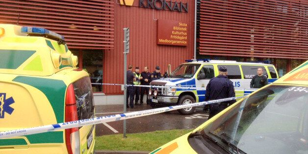 Emergency services attend the scene after a masked man attacked people with a sword, at the Kronan school...